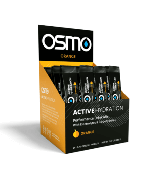 Orange and black colored box open to display Orange flavored single serving packets of Osmo Active Hydration