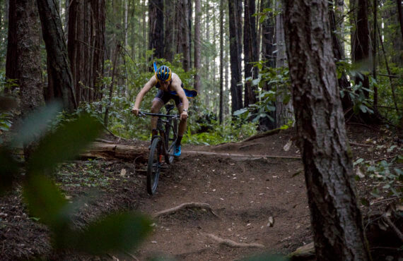 UCSC Mountain biker rips a trail through some trees