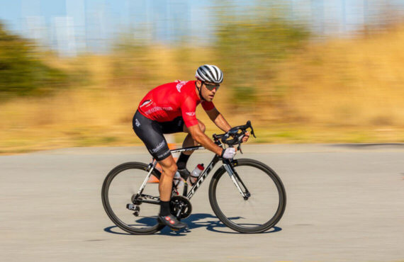 Chris Coble speeds by in his red jersey on a Scott bike