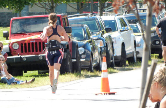 Roseann Peiffer seen running away from photographer towards a row of cars